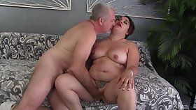 Fat woman drives a large dick up her pussy and mouth